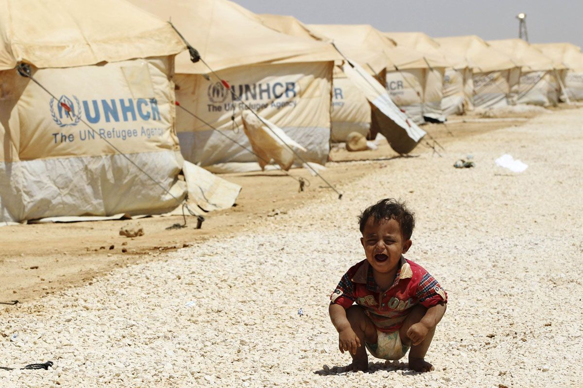 A Syrian refugee child cries at the Al Zaatri refugee camp in the Jordanian city of Mafraq, near the border with Syria, August 3, 2012. The Al Zaatri camp is one of many set up along the 86km (53 mile) border between Jordan and Syria under the management of the United Nations refugee agency (UNHCR) and with the help of local charity groups. Refugees were suffering from heat and difficult living conditions as even more people fleeing the fighting continued to pour into the camp on Friday. REUTERS/Muhammad Hamed (JORDAN - Tags: SOCIETY POLITICS CONFLICT TPX IMAGES OF THE DAY) ORG XMIT: AMM52